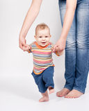 Baby taking first steps Royalty Free Stock Images