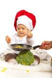 Baby taking macaroni Royalty Free Stock Image