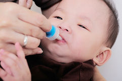 Baby taking medicine with dropper Royalty Free Stock Image