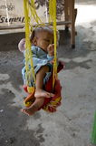 Baby taking a mid day nap at the market. Burma Stock Photos