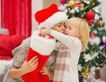 Baby taking out present from Christmas sock Stock Image