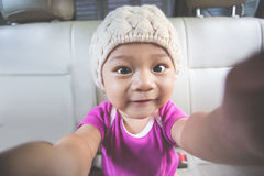 Baby taking selfie stock photos