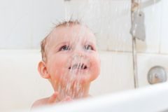 Baby taking shower Royalty Free Stock Image