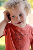 Baby talking on cellphone Royalty Free Stock Photography