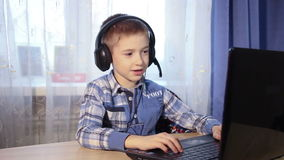 Baby talking on the internet, the boy talks to stock video footage