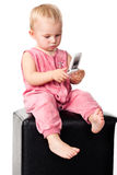 Baby talking on the mobile phone Royalty Free Stock Photo