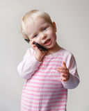 Baby talking over phone Royalty Free Stock Photo