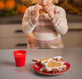 Baby tasting homemade christmas cookies in kitchen Stock Images