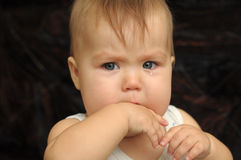 Baby in tears Stock Images