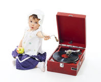 Baby technical support. Baby broke gramophone and need technical support to fix it,isolated on whie Stock Images