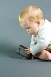 Baby and technology Royalty Free Stock Photography