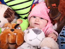 Baby and teddies Stock Image