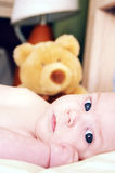 Baby Teddy. A 4 months old baby boy with a teddy bear Royalty Free Stock Photos