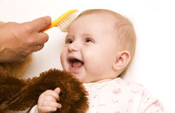 Baby with teddy Stock Images
