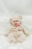 Baby teddy bear. Little child babyi n teddy bear costume smiling Stock Photos