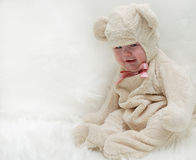 Baby teddy bear. Little child baby crying in teddy bear costume Royalty Free Stock Photos