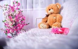 Baby teddy bear. Teddy bear on the bench, a teddy bear with the inscription `I love you Royalty Free Stock Image