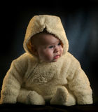 Baby in teddy bear cloth. Baby is wearing a warm teddy bear like winter coat Stock Photo
