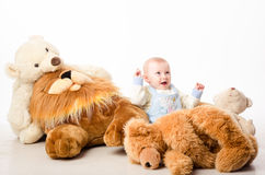 The baby and teddy Bear Stock Image
