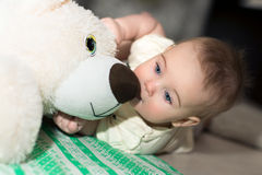 Baby and teddy bear. Royalty Free Stock Photography
