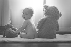 Baby with teddy bears