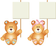 Baby teddy bears boy and girl holding a signboards Royalty Free Stock Images