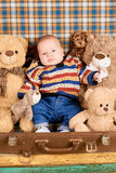 Baby, teddy bears and suitcase. Little child with toy animals. Toy safety tips Stock Photo