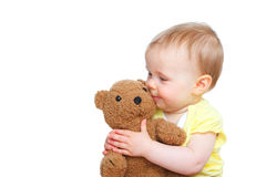 Baby with a teddy Stock Images