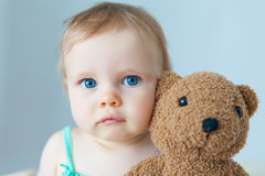 Baby with a teddy Royalty Free Stock Photo
