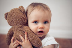 Baby with a teddy Royalty Free Stock Photos