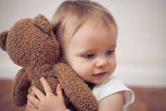 Baby with a teddy Royalty Free Stock Image