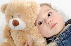 Baby with teddy Stock Image