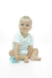 Baby with teether Royalty Free Stock Photo