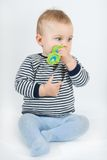 Baby with teether Stock Photo
