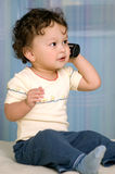 Baby with telephone. Royalty Free Stock Images