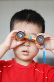 Baby with telescope Stock Photography