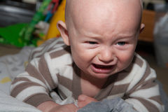 Baby Temper Tantrum. Baby with blue eyes crying and angry Royalty Free Stock Photos