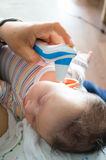 Baby temperature measuring Stock Photos