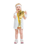Baby in tennis clothes holding medal and goblet Stock Image