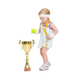 Baby in tennis clothes with medal and goblet. Isolated on white Stock Image