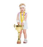 Baby in tennis clothes with medal and goblet Royalty Free Stock Images