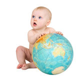 Baby and terrestrial globe. Baby and big terrestrial globe on the white royalty free stock photo