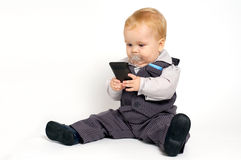 Baby texting. Blond baby in suit texting with mobile phone Stock Photography