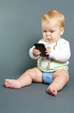 Baby texting smart phone stock images