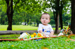 Baby in tha park Stock Images