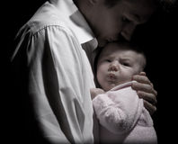 Baby and their loving father Royalty Free Stock Image