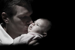 Baby and their loving father Royalty Free Stock Images