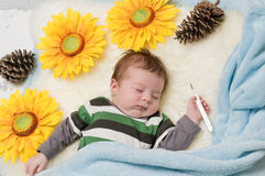 Baby with the thermometer Stock Photography