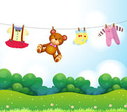 Baby things hanging royalty free illustration