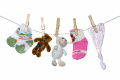 Baby things hanging on rope. Royalty Free Stock Photos